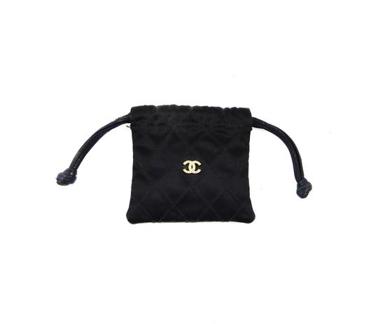 Preload https://item5.tradesy.com/images/chanel-drawstring-vintage-cc-rhinestone-cocomark-black-quilted-silk-leather-clutch-23755764-0-0.jpg?width=440&height=440