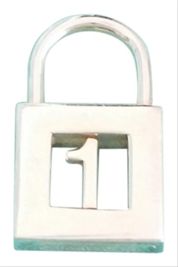 Preload https://item1.tradesy.com/images/tiffany-and-co-co-rare-alphabet-letter-number-1-padlock-pendant-charm-23755770-0-4.jpg?width=440&height=440