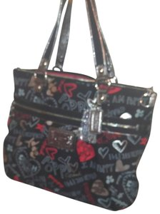 Coach Bag is in excellent condition. No signs of wear. The only sign is the inside lining. 8 inch strap drop Travel Bag