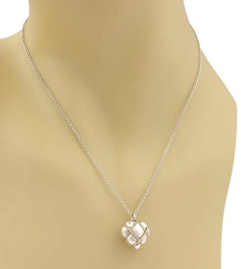 Preload https://item2.tradesy.com/images/tiffany-and-co-sterling-18k-yellow-gold-wire-wrap-heart-pendant-necklace-23756036-0-1.jpg?width=440&height=440