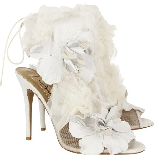 Preload https://item3.tradesy.com/images/valentino-white-ivory-mesh-floral-peep-toe-booties-pumps-size-eu-40-approx-us-10-regular-m-b-23756157-0-2.jpg?width=440&height=440