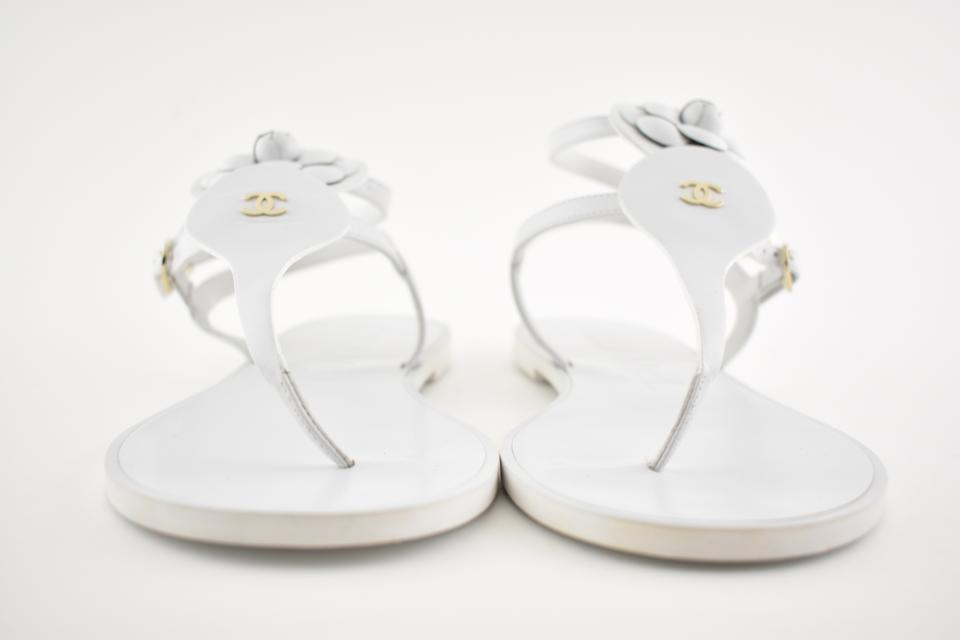 e5687359017 Chanel White 18c Leather Gold Camellia Ankle Strap Thong Flat Sandals Size  EU 40.5 (Approx. US 10.5) Wide (C