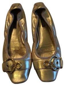 Louis Vuitton gold Flats