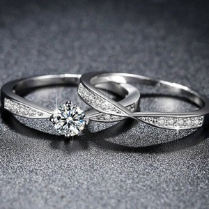 Silvertone And Engagement Ring