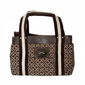 91219ae49 Added to Shopping Bag. Tommy Hilfiger Logo Small Canvas Tote in brown. Tommy  Hilfiger Hand Handbag Logo Classic ...