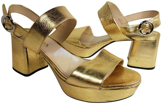 Preload https://img-static.tradesy.com/item/23776488/prada-gold-leather-chunky-heel-platform-sandals-size-eu-37-approx-us-7-regular-m-b-0-1-540-540.jpg