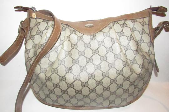 Preload https://img-static.tradesy.com/item/23779230/gucci-sukey-guccissima-print-canvasleather-cross-bodyshoulder-purses-shades-of-browngold-coated-canv-0-2-540-540.jpg