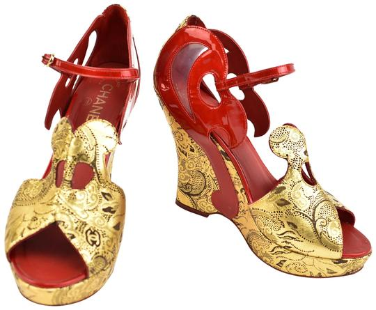 Preload https://img-static.tradesy.com/item/23781823/chanel-runway-red-and-gold-leather-cc-logo-sandalsheels-wedges-size-eu-385-approx-us-85-regular-m-b-0-1-540-540.jpg