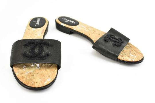 Preload https://img-static.tradesy.com/item/23781856/chanel-black-leather-and-cc-logo-flat-sandals-size-eu-365-approx-us-65-wide-c-d-0-0-540-540.jpg