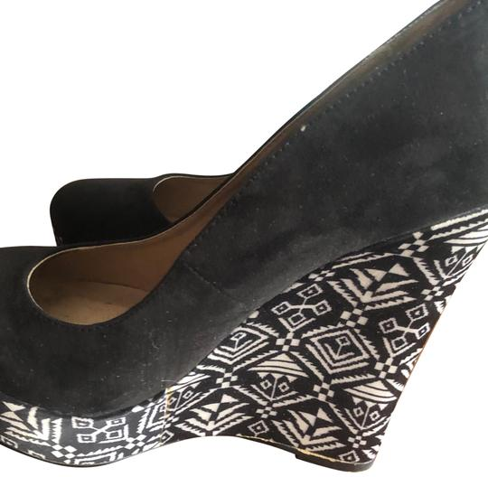 Preload https://item5.tradesy.com/images/forever-21-black-and-white-printed-wedges-size-us-8-regular-m-b-23782169-0-1.jpg?width=440&height=440