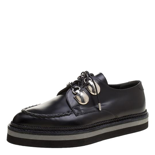 Preload https://item4.tradesy.com/images/alexander-mcqueen-black-leather-lace-up-creepers-flats-size-eu-37-approx-us-7-regular-m-b-23782438-0-0.jpg?width=440&height=440