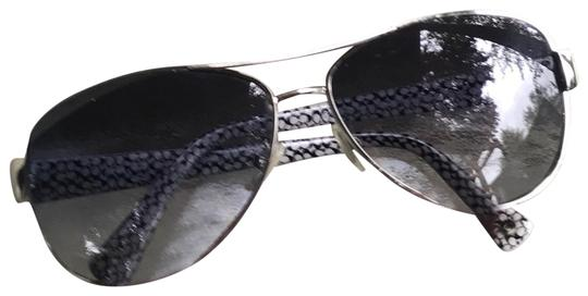 Preload https://img-static.tradesy.com/item/23782482/black-and-white-silver-signature-sunglasses-0-1-540-540.jpg