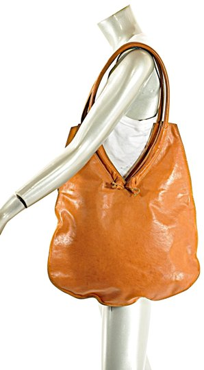 Preload https://item5.tradesy.com/images/barneys-new-york-smooth-handbag-with-knot-detail-cognac-leather-hobo-bag-23782499-0-1.jpg?width=440&height=440