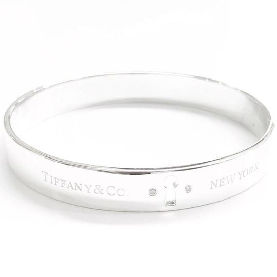 Preload https://img-static.tradesy.com/item/23788594/tiffany-and-co-diamond-keyhole-bangle-bracelet-0-3-540-540.jpg