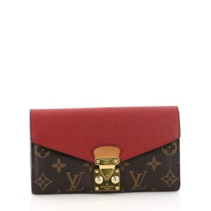 Louis Vuitton Wallet Canvas Leather Wristlet in brown with red