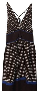 Donna Morgan short dress Brown polka dots on a cream background with blue accents on Tradesy