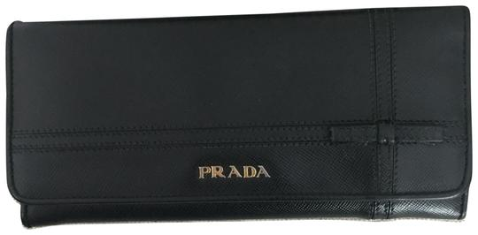 Preload https://img-static.tradesy.com/item/23813671/prada-black-saffiano-leather-with-bow-wallet-0-1-540-540.jpg