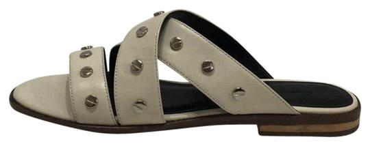 Preload https://img-static.tradesy.com/item/23817874/rebecca-minkoff-ivory-leather-susie-silver-studded-slide-sandals-size-us-85-regular-m-b-0-1-540-540.jpg