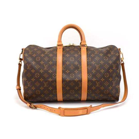 Preload https://img-static.tradesy.com/item/23818268/louis-vuitton-keepall-monogram-45-bandouliere-brown-coated-canvas-weekendtravel-bag-0-0-540-540.jpg
