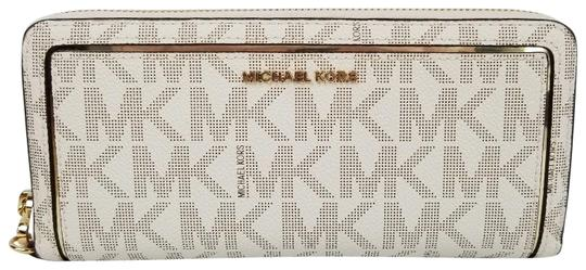 Preload https://item5.tradesy.com/images/michael-kors-vanilla-frame-out-travel-continental-boxed-wallet-23818294-0-1.jpg?width=440&height=440