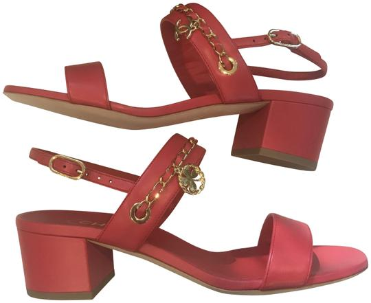 Preload https://item2.tradesy.com/images/chanel-red-18p-leather-chain-cc-clover-charm-heels-sandals-size-eu-39-approx-us-9-regular-m-b-23818376-0-1.jpg?width=440&height=440