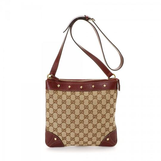 Preload https://item5.tradesy.com/images/gucci-monogram-gg-studded-messenger-867340-brown-coated-canvas-cross-body-bag-23818749-0-1.jpg?width=440&height=440