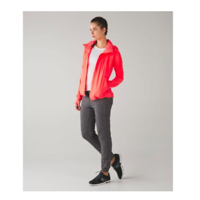 Preload https://img-static.tradesy.com/item/23818903/lululemon-bright-coral-gather-me-slightly-very-light-flare-activewear-outerwear-size-8-m-0-0-650-650.jpg
