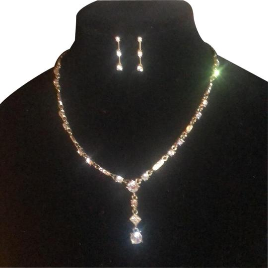 Preload https://img-static.tradesy.com/item/23821424/gold-and-clear-pierced-earrings-necklace-0-1-540-540.jpg