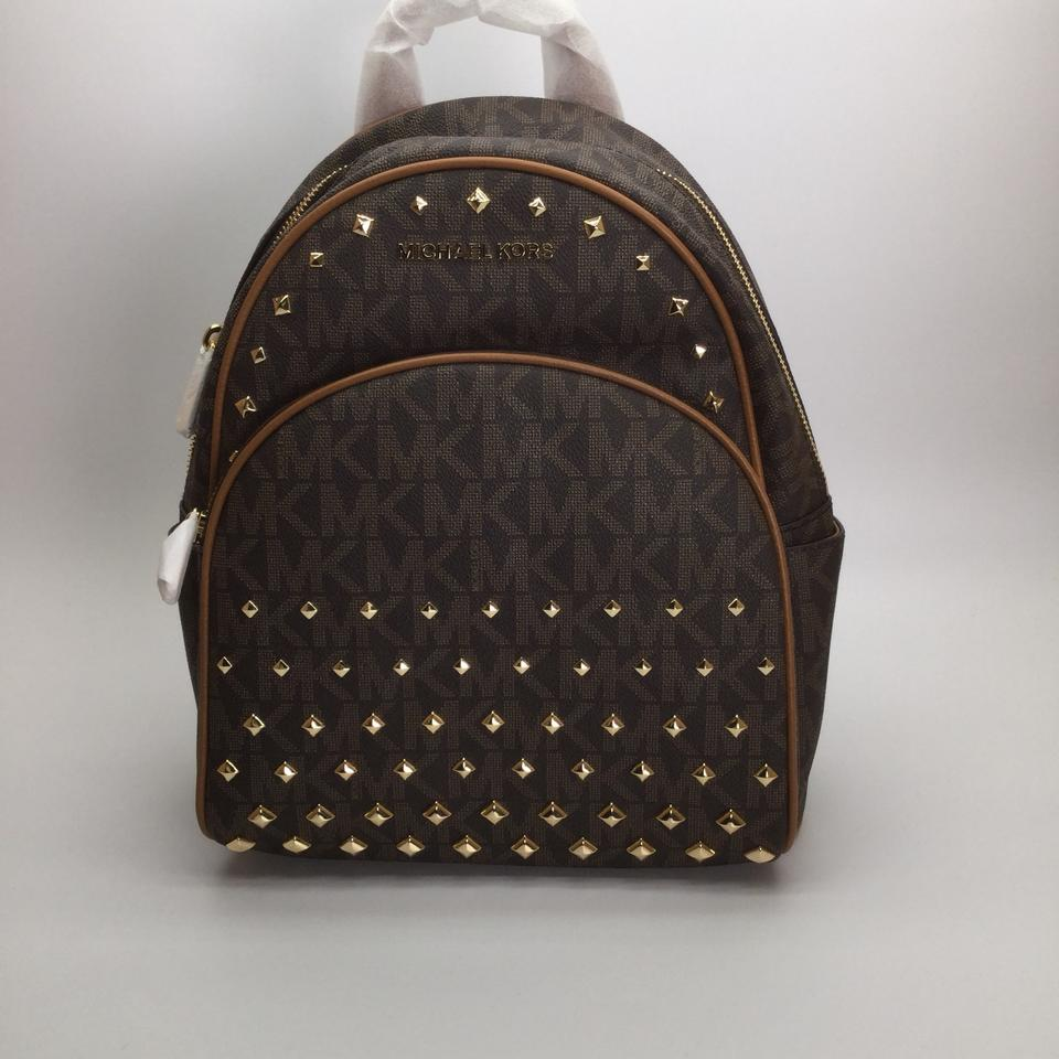 54cd2844c2d0 germany michael kors abbey medium mk signature studded brown accron leather  backpack d441f ef982