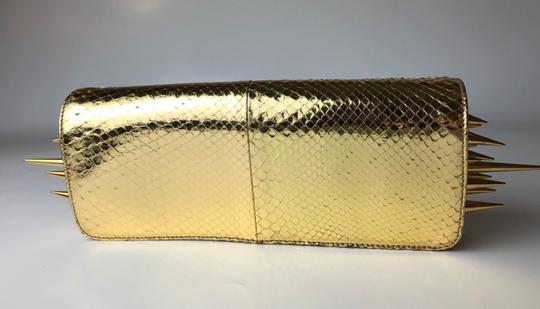 Christian Louboutin gold Clutch Image 1