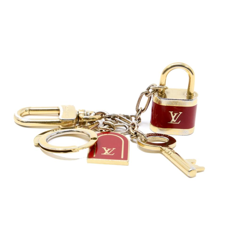 1711cd2fa8 Louis Vuitton LV Gold Cles Cadenas Key Chain Holder Bag Charm Image 0 ...