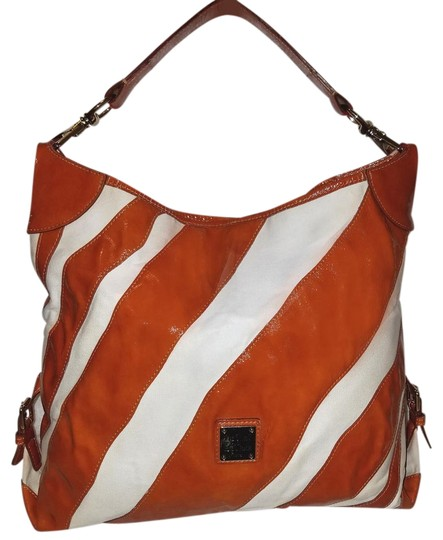 Preload https://item2.tradesy.com/images/dooney-and-bourke-extra-large-handbag-rrust-and-white-patent-leather-canvas-hobo-bag-23832481-0-1.jpg?width=440&height=440