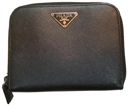 Preload https://img-static.tradesy.com/item/23832496/prada-black-saffiano-leather-compact-zip-around-wallet-0-8-540-540.jpg