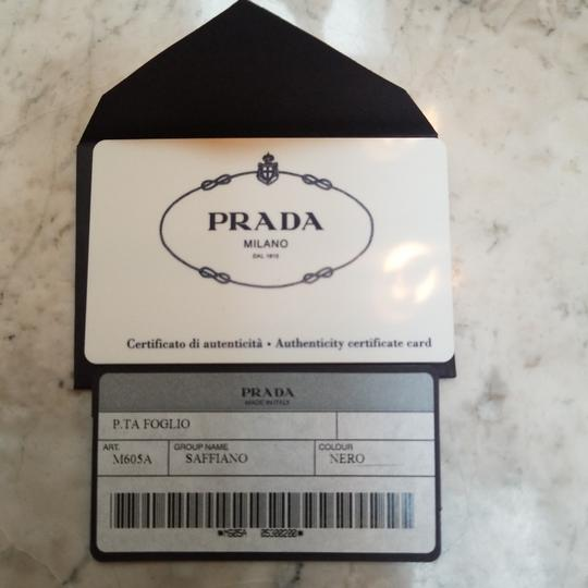 Prada Saffiano black leather compact zip around wallet
