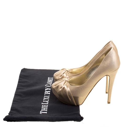 Preload https://img-static.tradesy.com/item/23832622/gold-metallic-lame-fabric-clair-platform-pumps-size-eu-385-approx-us-85-regular-m-b-0-0-540-540.jpg