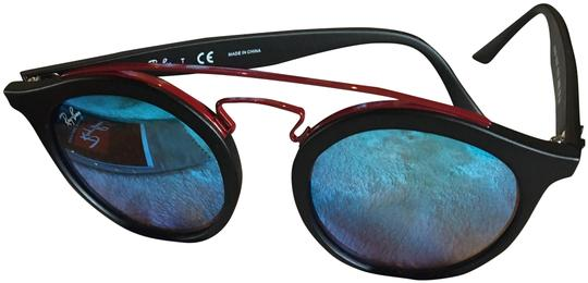 Preload https://item3.tradesy.com/images/ray-ban-black-frames-red-accent-blue-lens-20mm-gradient-gatsby-sunglasses-23832727-0-3.jpg?width=440&height=440