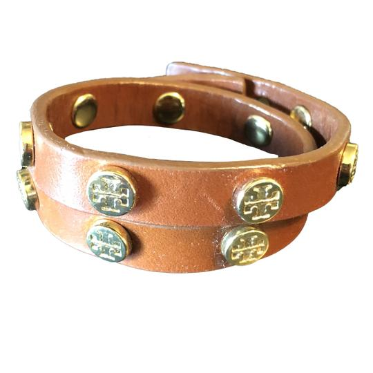 Preload https://item1.tradesy.com/images/tory-burch-light-brown-and-gold-double-wrap-logo-bracelet-23832805-0-0.jpg?width=440&height=440
