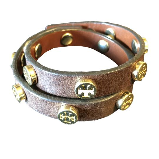 Preload https://item3.tradesy.com/images/tory-burch-dark-brown-and-gold-double-wrap-logo-bracelet-23832812-0-0.jpg?width=440&height=440