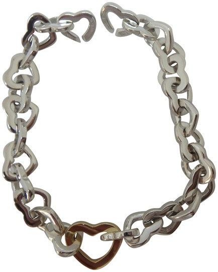 Preload https://img-static.tradesy.com/item/23837618/tiffany-and-co-sterling-silver-and-18k-yellow-gold-heart-link-bracelet-0-2-540-540.jpg