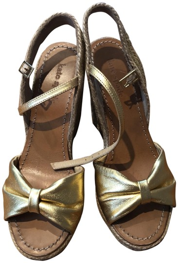 Preload https://img-static.tradesy.com/item/23838630/kate-spade-gold-espadrille-bow-metallic-jacee-sandal-wedges-size-us-7-regular-m-b-0-1-540-540.jpg
