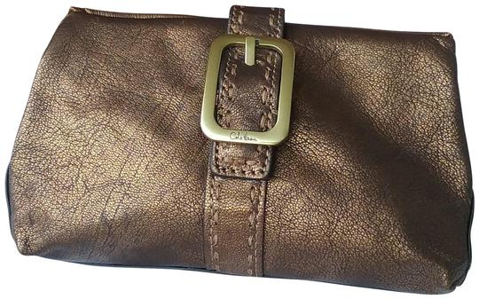 Preload https://img-static.tradesy.com/item/23842066/cole-haan-cosmetic-evening-bronze-leather-clutch-0-1-540-540.jpg