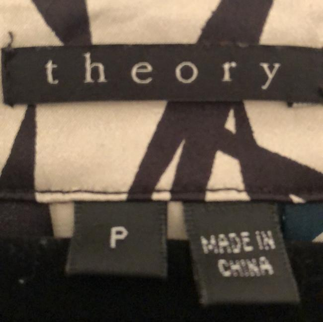 Theory Top Multi with black and some purple with cream background