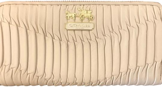 Preload https://item5.tradesy.com/images/coach-bone-madison-zip-around-accordion-wallet-23848249-0-1.jpg?width=440&height=440