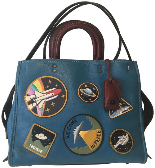 Preload https://item2.tradesy.com/images/coach-1941-rough-space-patches-blue-natural-pebble-leather-shoulder-bag-23848376-0-1.jpg?width=440&height=440