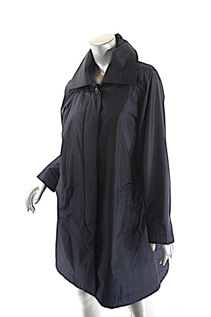 Preload https://item2.tradesy.com/images/issey-miyake-dark-navy-poly-silk-blend-gently-filled-hidden-placket-trench-coat-size-12-l-23848501-0-0.jpg?width=400&height=650