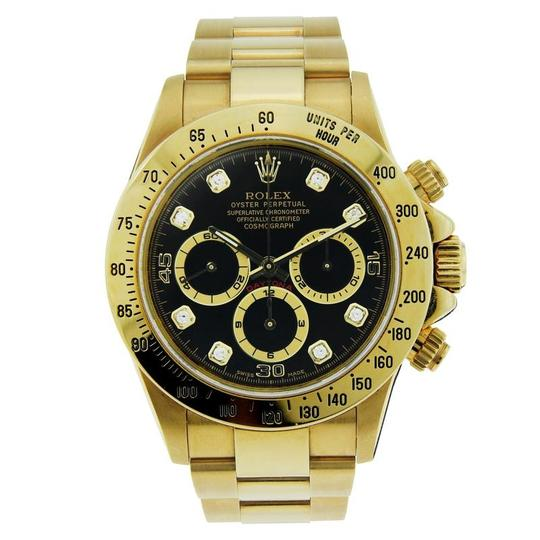 Preload https://item2.tradesy.com/images/rolex-yellow-gold-and-black-daytona-18k-with-dial-diamond-markers-40mm-watch-23848721-0-0.jpg?width=440&height=440