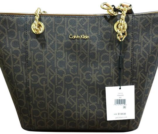 Preload https://item2.tradesy.com/images/calvin-klein-monogram-chainlink-tote-brown-faux-leather-satchel-23848741-0-1.jpg?width=440&height=440