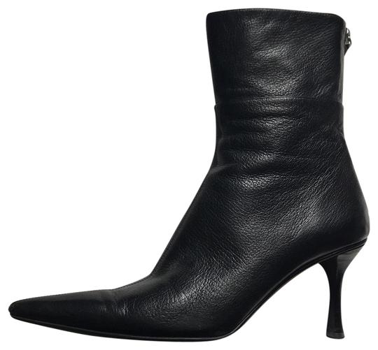 Preload https://img-static.tradesy.com/item/23848913/gucci-black-bootsbooties-size-us-75-regular-m-b-0-1-540-540.jpg