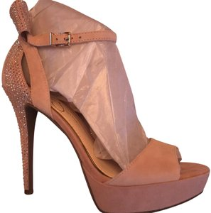 Jessica Simpson Blush Nude with Rhinestone And Bow detail. Heel height is 4.5 inches with a 1 inch platform. super Comfortable. Never been worn. Purchased for a wedding but didn't end up attending. NWT in original box Platforms