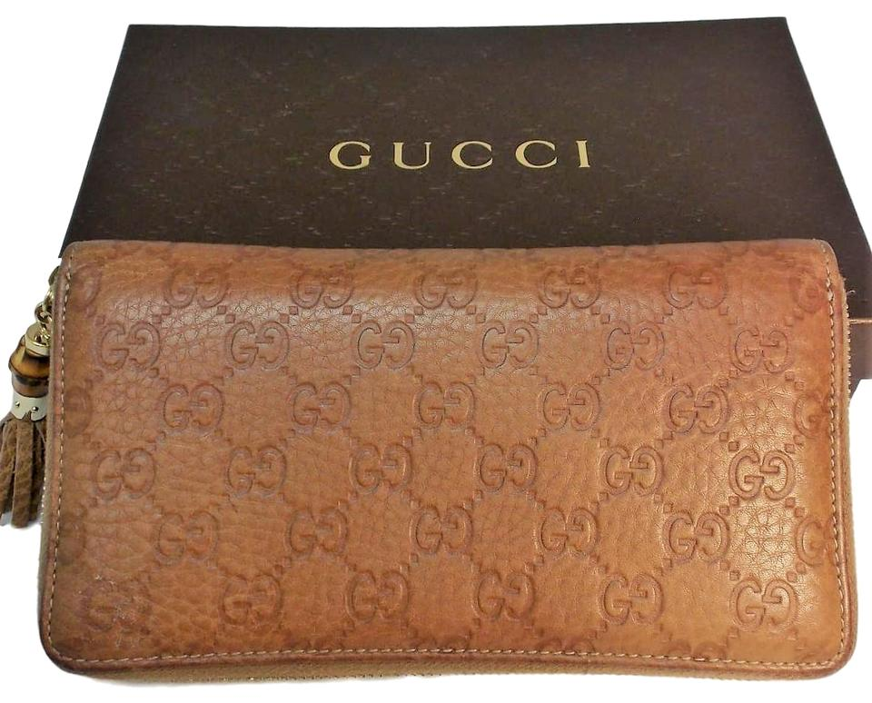 a479f460f64 Gucci Brown Leather Monogram Bifold Zip Around Wallet - Tradesy